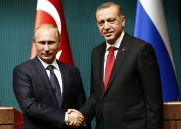 Russia's President Putin shakes hands with Turkey's President Erdogan after a news conference at the Presidential Palace in Ankara